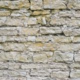 Old castle brick wall. Old castle limestone brick wall as an abstract background composition royalty free stock photos