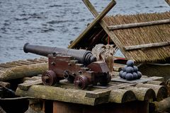 Old castle cannon and cannon balls. Old castle cannon with cannon balls Royalty Free Stock Image