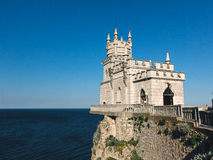 The old castle on a cliff. Stock Image
