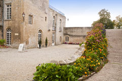 Old castle with courtyard and beautiful border. Old French castle at Creully with courtyard and beautiful border with flowers Stock Photo