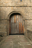 Old Castle Door. Most cstle doors have been repalced but this one has been repaired and still contains features from the original one royalty free stock photo