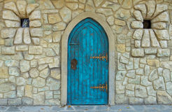 Old castle door. Design and vintage stone walls Stock Photo