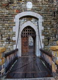 Old castle door and drawbridge. A door to an old stone built castle Royalty Free Stock Image