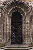 Old Castle Door Oval-shaped Among Rocky Masonry Royalty Free Stock Photo