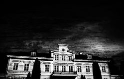 Old castle edited with black background. Photo from ground level angled up. stock images