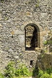 Old castle entrance door in the wall Stock Image