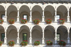 Old castle facade with arches and columns Stock Image