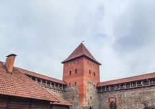 The old castle is a fortress made of stone and red brick. Belarus royalty free stock image