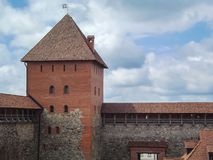 The old castle is a fortress made of stone and red brick. Belarus stock images