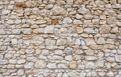 Old castle or fortress stone wall made of stacked stone blocks royalty free stock image