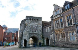 Old castle gate on modern British street Royalty Free Stock Photos