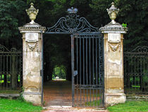 Old castle gate before park royalty free stock photo