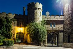 Old castle gates at night. Entrance to former earl Vorontsov`s manor, Alupka, Crimea.  stock photos