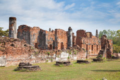 Old castle and green field. Old castle in Ayutthaya Thailand with green field. Buddhist Temple Royalty Free Stock Photos