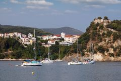 Old castle on hill and Parga town Greece. Summer season stock image