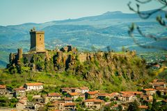 Castle on a hill in France. Old castle on a hill with the village at the bottom of the hill royalty free stock photos