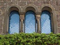 Old castle house window. On the sun Stock Photos