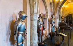 Old castle interior with knight`s armor, Europe