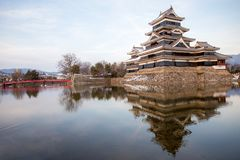Old castle in japan. Matsumoto castle against blue sky in Nagono city, Japan royalty free stock photography
