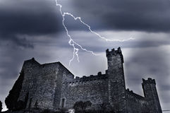 Old castle with lightning. Old castle with dark ominous clouds and lightning stock images