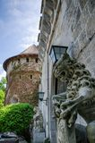 Old castle with lion. Constable statute Stock Image