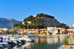Old castle in a mediterranean city and the harbor. Old castle in a mediterranean city with its reflection in the sea and the barbor Stock Image