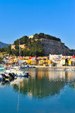 Old castle in a mediterranean city and the harbor. Old castle in a mediterranean city with its reflection in the sea and the harbot Royalty Free Stock Photography