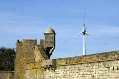 Old castle and modern windmill, Portugal Royalty Free Stock Photography