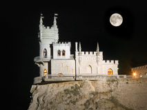 Old castle and Moon Stock Image