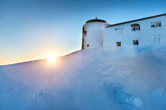 Old castle on the mountain with snow Royalty Free Stock Images
