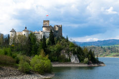 Old Castle in Niedzica. Old castel on hill near too lake in Niedzica city stock image