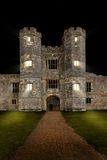 Old castle at night with lights shining Royalty Free Stock Images