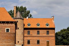 Old castle in Poland. Old orange-coloured castle in Poland with tower Stock Photography