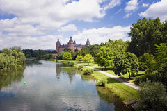 Old castle and river. The river main passing castle johannisburg near aschaffenburg, germany Stock Photos