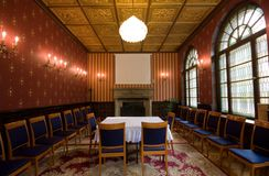 Old castle room. With chairs stock photos