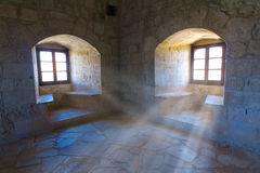 Old castle room. In a rays of sun stock photos