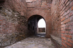 Old castle ruin with arches. Old castle ruin hallway with arches and walls Stock Images