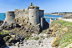 Old castle ruins in Yeu Island. Ruins of old medieval castle of the Isle of Yeu make a part of wild coastline in South of Yeu Island, Atlantic ocean is at left Royalty Free Stock Photography
