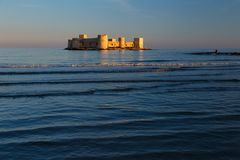 Old castle in mediterranean. Old castle in the sea at sunset at mediterranean Stock Photography