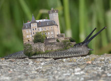 Old castle on the snail. Abstract picture of an old castle resting on snails backs. Sarcastic and abstract at the same time Royalty Free Stock Images