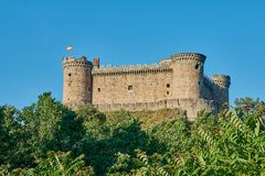 Old castle with a spanish flag stock photography