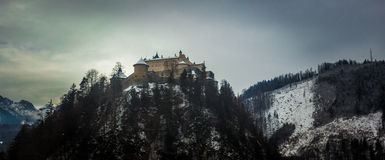 Old castle standing on high mountain at Austrian Alps Stock Image