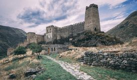 Old castle in the state among the mountains under a stormy sky royalty free stock photos