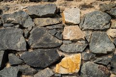 Old castle stone wall texture background in perspective.  stock photography