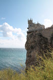 Old castle Swallow's Nest on the edge of cliff above the blue sea Royalty Free Stock Image