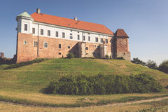 Old castle from 14th century in Sandomierz is located by Vistula Stock Images