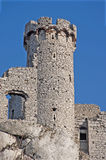 Old castle tower. Old stone tower on the rock in the ruins of the medieval castle in Ogrodzieniec, Poland, on blue sky Stock Photo