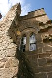 The old castle tower. Window on a castle tower Royalty Free Stock Photos