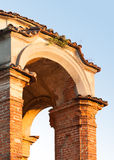 Old castle tower arch top. Old middle-age castle tower arch top featured with bricks and shingles Royalty Free Stock Photography