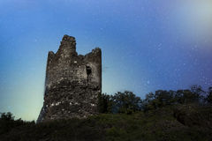 Old castle tower on a night sky background Stock Photo